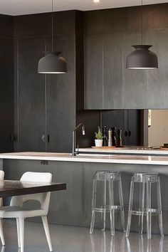 This beautiful black toned European gourmet kitchen with quality Miele appliances set the tone for this home in Melbourne. | homeadverts.com