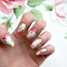 Create this stunning floral nail art with this simple step by step guide!