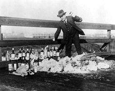 """Despite the best efforts of authorities, Seattle remained """"wet"""" during Prohibition. Here, King County Sheriff Matt Starwich destroys bottles of confiscated alcohol, ca. 1925. (History By Zim)"""