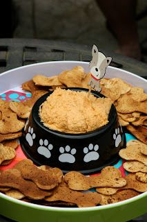 dog bone shaped chips served with dip out of new dog bowl
