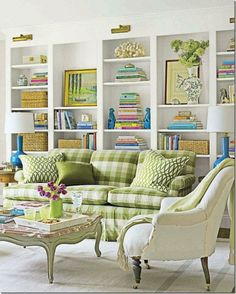 Meg Braff killing me as usual with a bright and happy family room space. Beautiful, fresh apple green and white palette with pops of blue. Love that big gingham couch, the white built-ins with gold library lighting above and perfect styling on the shelves - especially those turquoise foo dogs.