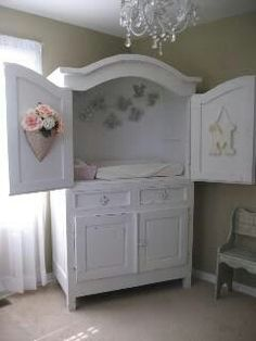 Tv entertainment stand turned into baby changing station... too cute