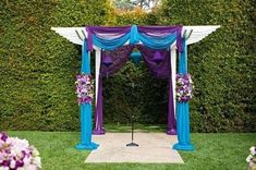 Another pretty arch idea. Just use rolls of tulle. Shouldn't be too pricey either!