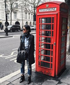 Margaret is wearing a Coach coat, 3x1 jeans, Senso shoes, Givenchy bag, Prada sunglasses, and an ASOS scarf
