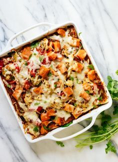 Delicious enchilada casserole stuffed with roasted veggies, black beans, salsa and spinach! This is a hearty and redeeming dinner recipe. http://cookieandkate.com