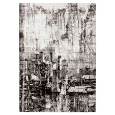 Anchor your living room seating group of define space in the den with this artfully crafted rug, showcasing an abstract motif in charcoal and ivory.