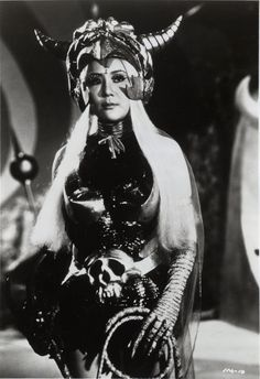 Princess Dragon Mom (played by Terry Liu). Infra-Man, 1975 ''Greetings to you, Earthlings, I am Princess Dragon Mom. I have taken over this planet, now I own the Earth and you'll be my slaves for all eternity! Japanese Monster Movies, Future People, Space Party, Retro Futurism, Archetypes, Spooky Halloween, Headgear, Science Fiction, Pop Culture