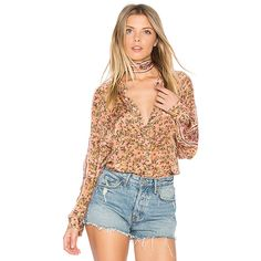 Free People Skyway Drive-In Top ($110) ❤ liked on Polyvore featuring tops, blouses, fashion tops, floral necktie, floral blouse, red blouse, free people tops and floral print blouse