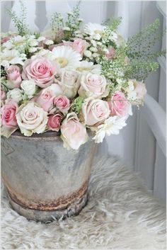 Love the shabby chicness of the pale pink roses, white daisies, and baby's breath in the old galvanized bucket. Description from pinterest.com. I searched for this on bing.com/images