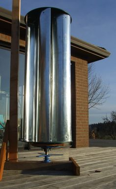 The Zoetrope is a vertical-axis wind turbine made from common materials such as stove pipe, metal brackets, plastic sheet and a trailer hub.