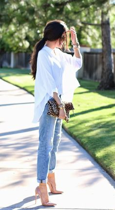 denim + oversized shirt + leopard clutch + nude loubs