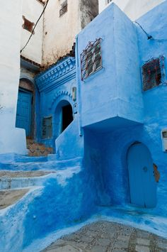 blue-painted street in Chefchaouen, Morocco. Chefchaouen is situated in the Rif Mountains, just inland from Tangier The Places Youll Go, Places To See, Voyager C'est Vivre, Photo Bleu, Places To Travel, Travel Destinations, Magic Places, Africa Travel, Morocco Travel