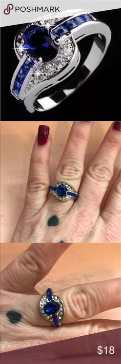 🌹🌹 PRETTY RING White and blue on a silver setting.  📫 SAME/NEXT DAY SHIPPING  🚭 SMOKE FREE  🐶 PET FRIENDLY 💎 BOUTIQUE ITEMS MAY NOT HAVE TAGS 🔱 NO TRADES 👗 NO MODELING 🌹 REALISTIC OFFERS WELCOME  📦 ANY BUNDLES OF 10 OR MORE, SUBMIT OFFER FOR 50% OFF Jewelry Rings