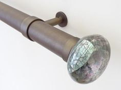 50mm diameter brushed bronze curtain pole with mother of pearl riva ellipse finials