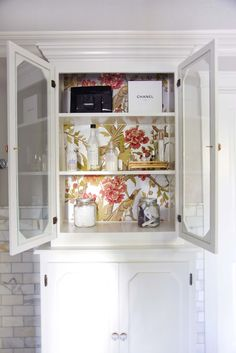 So pretty, how she added wallpaper to the back of the cupboard
