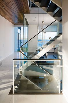 Glass stairs in Amazing Ottawa River House by Christopher Simmonds Architect Home Interior Design, Interior Architecture, Ottawa River, Staircase Storage, Escalier Design, Riverside House, Glass Stairs, Glass Walls, Modern Stairs