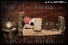 A real wood physical newborn log bed photography prop with a matching nightstand end table. This is a photo shoot prop ONLY and not for actual