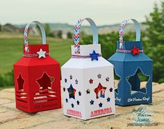 I stamped in red and blue, then embossed in white on the blue lantern. I added some twine and a cute star button to finish them off.