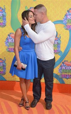 WWE stars John Cena and Nikki Bella showed their love at Nickelodeon's 27th annual Kids' Choice Awards in Los Angeles on March 29, 2014. We wonder if they arm wrestle to settle arguments?RELATED:: Kristen Bell and Dax Shepard lock lips, plus more celeb PDA