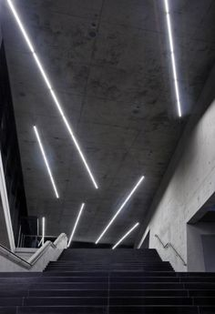 Small Olympic Hall / Pfarré lighting design inside open concrete space