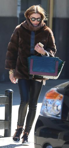 Chic in the city: The reality star turned Front Row regular was well wrapped up for the lingering NYC chill