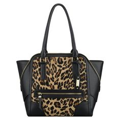 "Grrr! Our Punch Love leopard print tote is definitely a fierce choice this season and one of our most popular animal print handbags. Features include inside pockets and top-zip closure. An outer zip pocket provides quick and easy access for keys, phone, driver's license, etc. Top-zip closure. Red fabric lining. Man-made materials with shiny metal hardware. Imported. Two handles with an 8 1/2"" drop. 18""L x 12 3/4""H x 3 3/4""D."