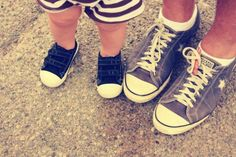 Buy her a pair of Chucks as soon as she starts walking. She won't always want to wear matching shoes with her old man.