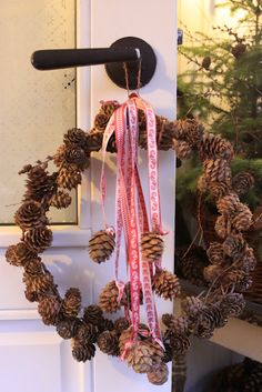 Pine cone wreath and ribbons. Repinned by www.mygrowingtraditions.com