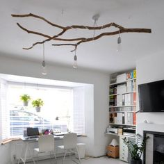 Learn how to create a statement chandelier light out of the fallen tree branch.
