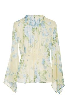 This **Alice McCall** Love on Top blouse features a collared neck, flare sleeves, and the butter blossom print.