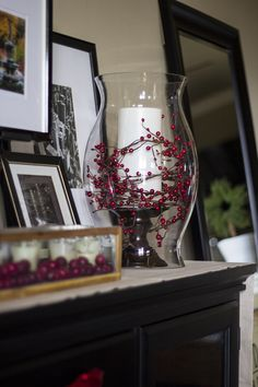 hurricane vase and candle with holly berries - the Stiers Aesthetic