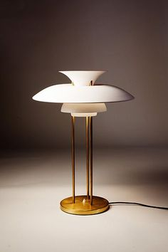 Poul Henningsen's PH5 as a table lamp. I would go for silver or copper for the metal tone.