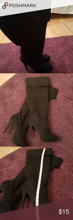 Long black boots Boots are about 21 inches and go up to my knees. There's a 1 inch platform in the front.  The heels are 4 inches.  Only worn once. Shoe Dazzle Shoes Heeled Boots