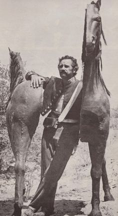 MAJOR DUNDEE (1965) - Stuntman Chuck Hayward poses with a prop horse - Directed by Sam Peckinpah - Columbia Pictures