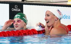 Ruta Meilutyte of  Lithuania celebrates a record time with Jessica Hardy of the USA during the Swimming Women's 100m Breaststroke preliminaries heat seven on day ten of the 15th FINA World Championships at Palau Sant Jordi on July 29, 2013 in Barcelona, Spain.