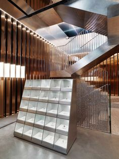 An aluminium foam staircase doglegs up the centre of Italian jewellery brand Repossi's flagship store by OMA