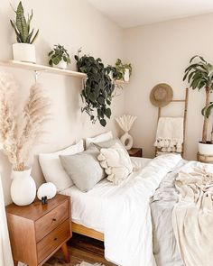 @rachelkathleen13 brings the outdoors inside with her nature-filled bedroom 😍😍😍. Click the image to try our free home design app.  (Keywords: bedroom ideas, bedroom decor, master bedroom ideas, boho bedroom, dream rooms, DIY home decor, small bedroom ideas, bedroom rug, aesthetic bedroom, bedroom wall art, apartment bedroom decor) Boho Bedroom Diy, Apartment Bedroom Decor, Bedroom Wall, Bedroom Inspo, Modern Boho Master Bedroom, Bedroom Ideas, Minimalist Bedroom, Boho Chic Interior, Interior Design