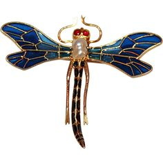 The most wonderful of all dragonfly pins, ours is made of solid 14kt yellow gold with enamel.  The abdomen section of the dragonfly is set with