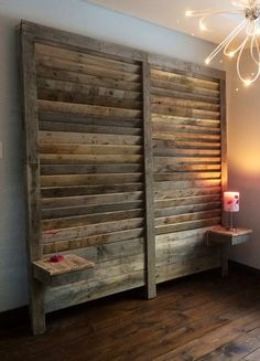 Large, tall, slated louvered style headboard with built in nightstand