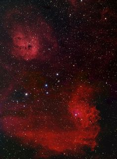 The pairing by David Davies of the emission nebulae IC405 and IC410 in the winter constellation of Auriga, the Charioteer makes for a stunning picture. To the bottom of the picture lies IC405, popularly known as the Tadpole Nebula and Caldwell 31, a huge, sprawling nebula spanning five light years and surrounding the 'Flaming Star', AE Aurigae, the bright star visible in the upper portion of the nebula. AE Aur (mag. +6)