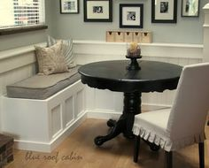 kitchen nook... banquette out of salvaged doors..  I like the incorporating black accents to this room!