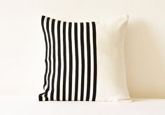 Simple , Graphic and Modern Striped Black and White Suede Pillow Cover, perfect addition to your modern home!  Black Stripes have been appliqued on to an off white base, front and back both are made in faux suede fabric. Over locked edges and concealed YKK zip at the back makes this a high finish product.  Wish to customize this product? Write to me and we can work on your custom product together! Size shown in the pic is 16 x 16 inches or 40 x 40 cms  Dry Clean Only! Filler / Insert is not…