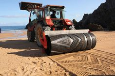 The Tractor Is To Create Patterns On The Beach (5 Photos)