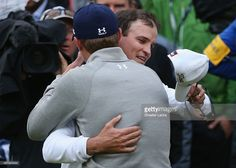 Zach Johnson of the United States celebrates with Jordan Spieth of the United States after winning the 144th Open Championship at The Old Course during a 4-hole playoff on July 20, 2015 in St Andrews, Scotland.  (Photo by Streeter Lecka/Getty Images)