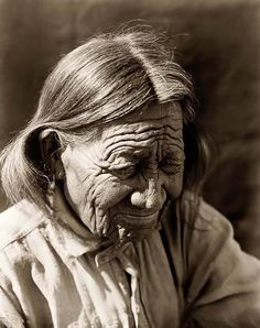 You are looking at an educational picture of an old Arapaho. It was taken in 1910 by Edward S. Curtis.    The picture presents Arapaho person, head-and-shoulders portrait, looking downward to the right.
