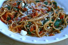 Garlic infused spaghetti with a fresh spinach and tomato sauce. You'll never buy canned spaghetti sauce again!
