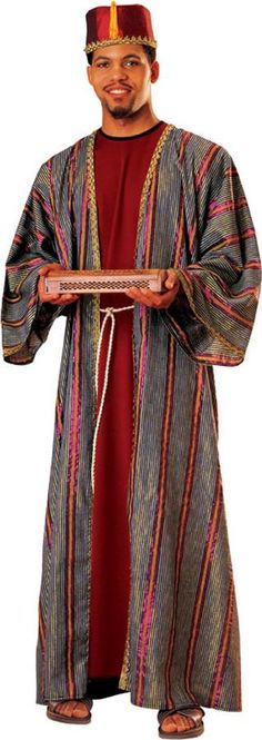 Complete the Christmas pageant by having yourself or someone dress as Balthazar, one of the magi mentioned in the Bible, in our Balthazar Adult Costume! Our Balthazar Adult Costume includes a hat with a tassle and striped soft robe with an attached belt cord, both trimmed with a gold braid. This fits most adult sizes. Additional biblical and religious costume accessories are available and sold separately.