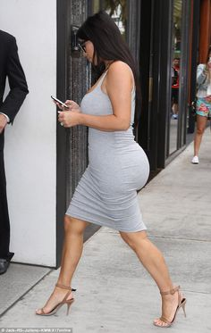 Bumping along nicely: Pregnant Kim showed off her incredible figure as she marched into a boutique store