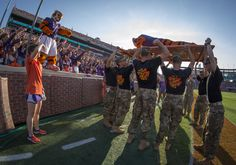 https://flic.kr/p/NKPdUu | 161105-A-ZU930-009 | Cadets with Clemson Universityâs Reserve Officersâ Training Corps hold up the Clemson Tiger to do push-ups after the Tigers scored a touch-down during the Military Appreciation Game against Syracuse, Nov. 5, 2016. (Photo by Ken Scar)