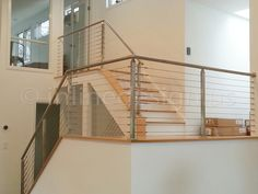 Bryan - NY gallery from Inline Design's modern stainless steel cable, glass, and bar railing systems for residential & commercial spaces